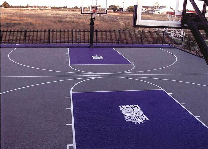 Outdoor basketball floor gurus floor for How much does it cost to build indoor basketball court